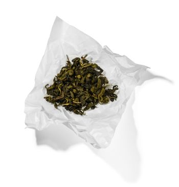 Green tea top view on white background.