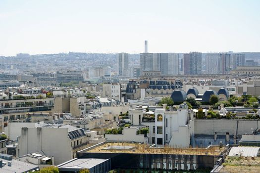 Paris cityscape with roof gardens with high-rise buildings and apartments beyond in the densely built French city