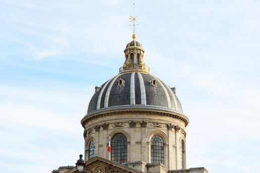 Ornate gilded dome and weather vane of the French Institute in Paris - Institut de France