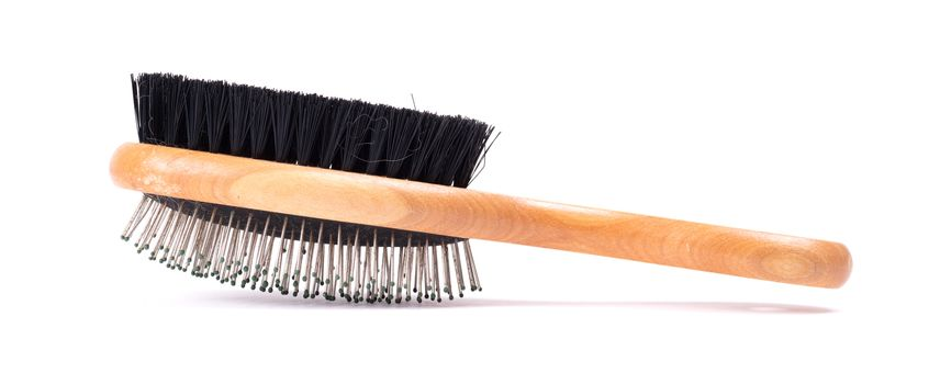Old brush for dog or cat hair, used - Isolated on white