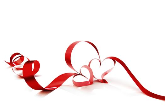 Hearts from red ribbon isolated on white background