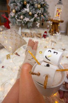 Snowman marsjhmallow on hot chocolate at Christmas
