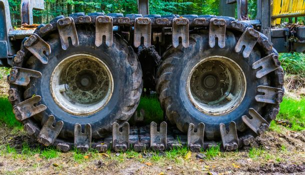 ground working vehicle tires with caterpillar, construction equipment, earthmoving industry background