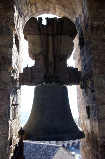 copper bell in Romanesque church bell tower