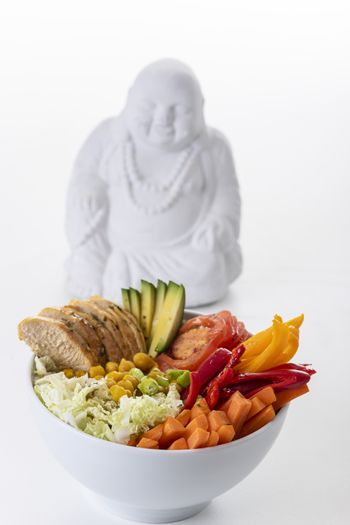 buddha bowl with chicken on white