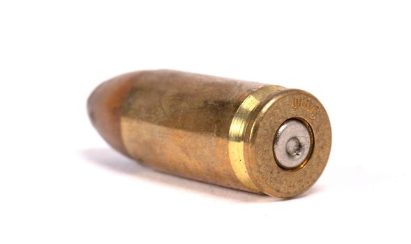 Very old bullet isolated on a white background