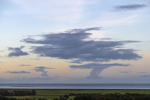 Impressive skies over the mainland of the province of Friesland from the Dutch island of Terschelling in the northern part of the Netherlands