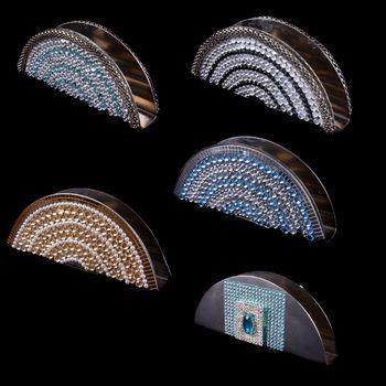 Luxurious Tissue holders in different designs, on black studio background.