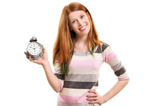 Time concept. Portrait a beautiful young girl holding an old fashioned alarm clock and smiling, isolated on white background.