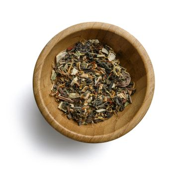 Green tea with aromatic additives. Top view on white background.