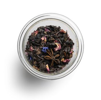 Black tea with natural aromatic additives. Top view on white background.