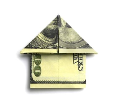 100 us dollars in the shape of a house on a white background.