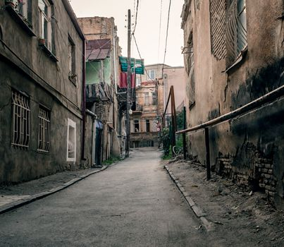 slum old town street with ruined shacks