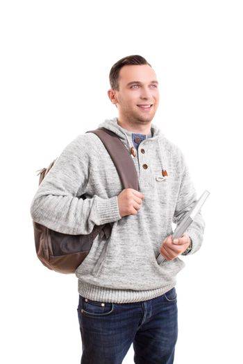 Portrait of a young male student with a backpack holding a notebook, isolated on white background.