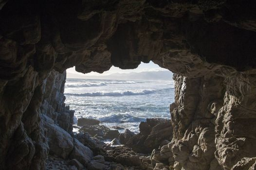 Rocky cave viewing over the sea in South Africa
