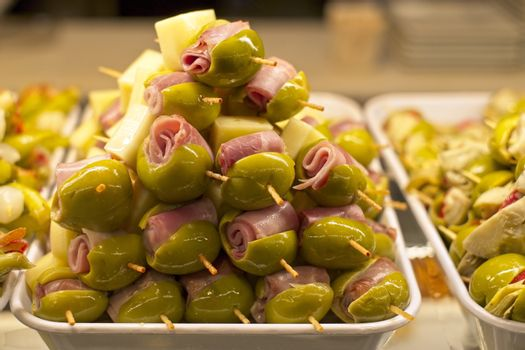 Tapas with olives, ham and cheese