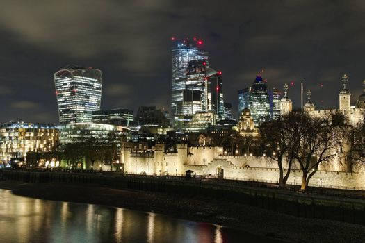 Skyline of the financial district and Tower of London at night