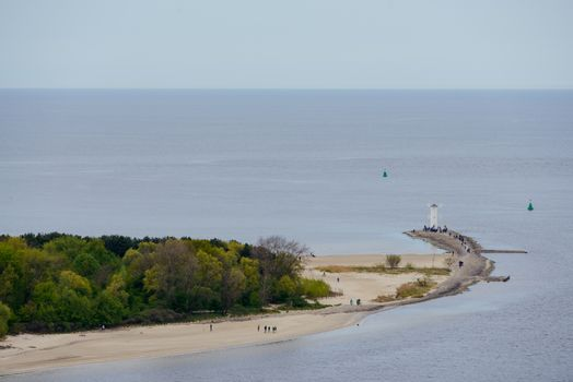 Old lighthouse in Swinoujscie, a port in Poland on the Baltic Sea. The lighthouse was designed as a traditional windmill. Panoramic image