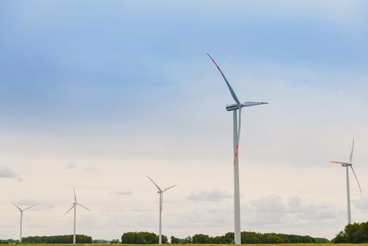 Windturbine. Eco power renewable energy production from wind. Windmill saves the earth's natural ingredients. Green ecology and pure electricity.