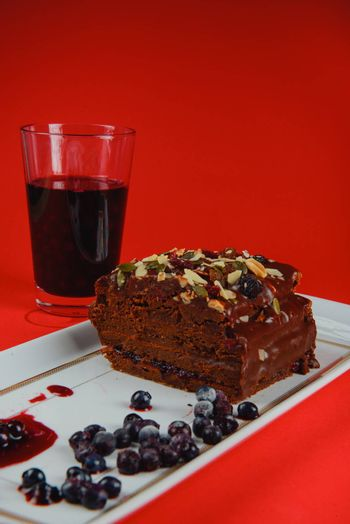 Chocolate cake with raisins lies on the table