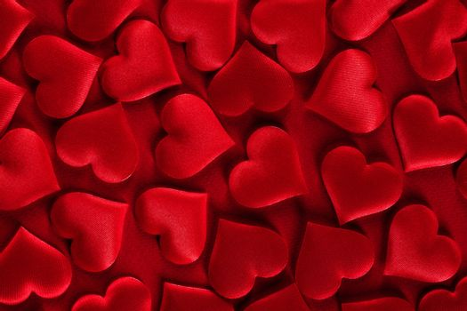 Valentine's day many red silk hearts background, love concept