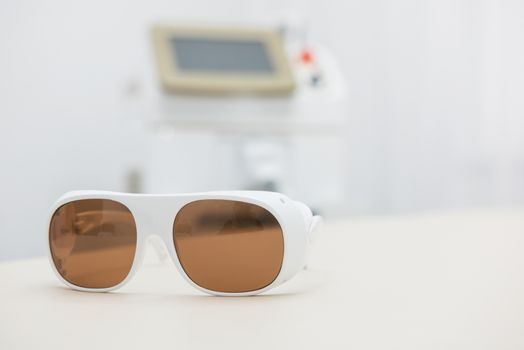 Protective glasses on laser epilation equipment