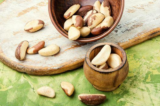 Bertholletia.Peeled brazil nut in wooden mortar.Healthy food