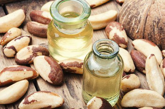 Gourmet peeled Brazil nut and jars of oil.