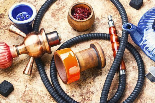 Details of tobacco hookah and teapot with tea.Eastern smoking shisha