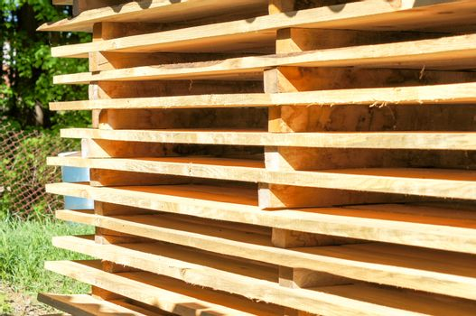 Wooden pallets stacked in the open air