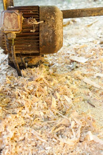 Wood chips Flakes and sawdust or fiber used as raw materials in the production of wood pellets background.