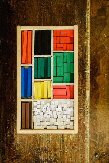 Blocks of different sizes and colors to build shapes and count.