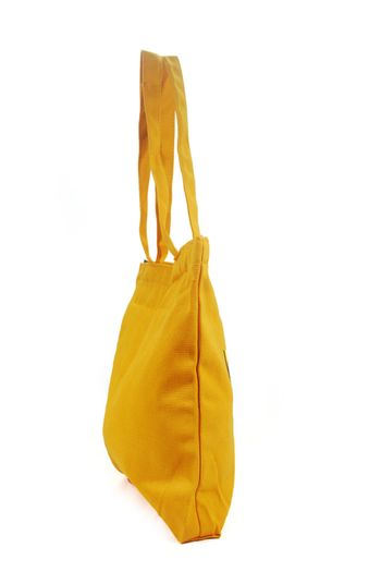 The yellow cloth bag is used for recycling.