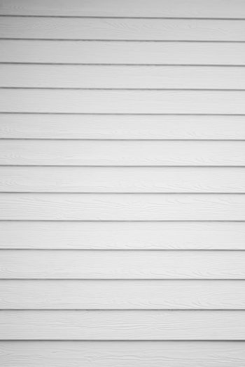 White painted wooden house wall.White plank background.