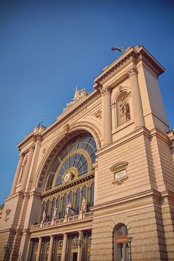 Side view of the main entrance of Keleti Railway Station in Budapest, Hungary with clear blue sky in the background. Eastern railway station in Budapest.