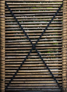 Bamboo fence. Gates made of natural bamboo.