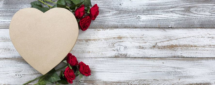 Happy Valentines Day with large gift box in shape of heart and red roses