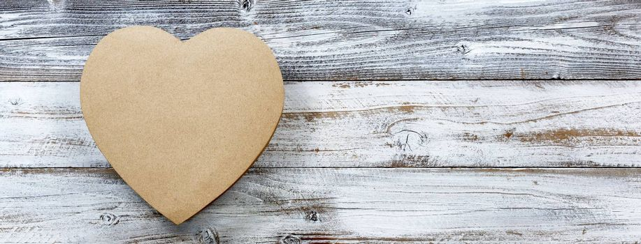 Happy Valentines Day with large gift box in shape of heart