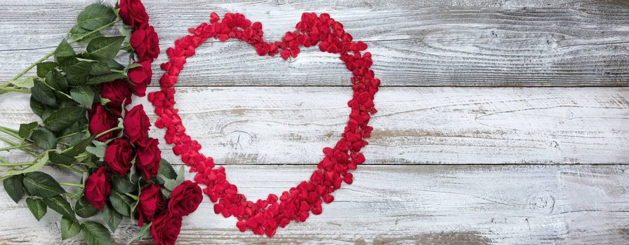 Happy Valentines Day with tiny hearts and red roses on white rustic wood