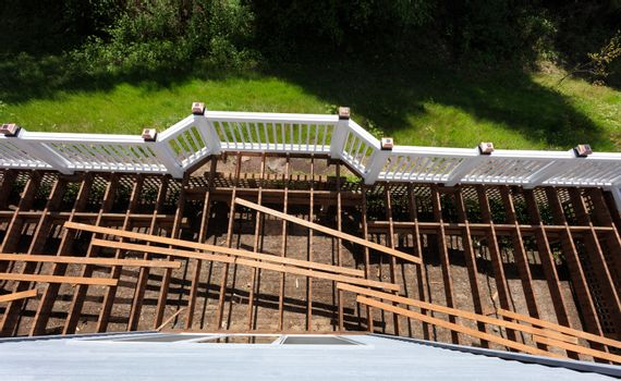 Top view of an aged outdoor wooden cedar deck being tore down du