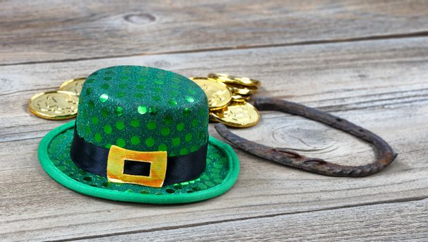 Close up of Lucky hat for St Patrick on rustic wooden background
