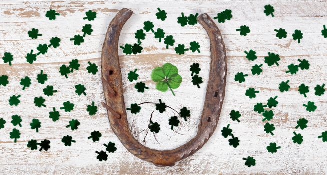 St Patrick Day lucky items on rustic white wood