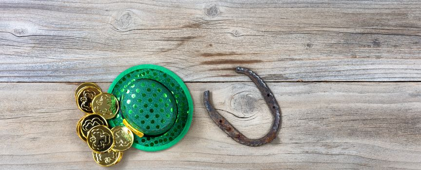 Lucky St Patrick objects on rustic wooden board background