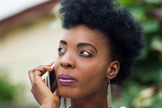 Close-up of a young woman focused on her communication