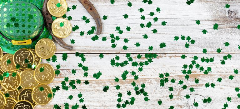 Lucky hat and gold for St Patrick Day on rustic wood