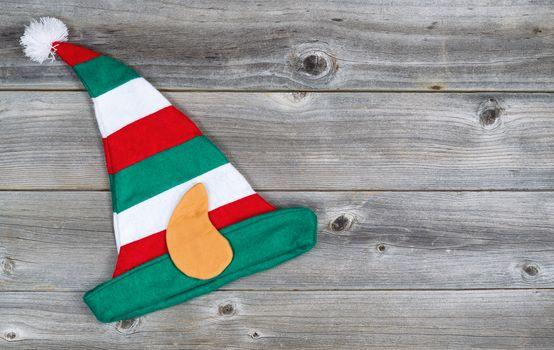 Christmas Elf Stocking on rustic wood