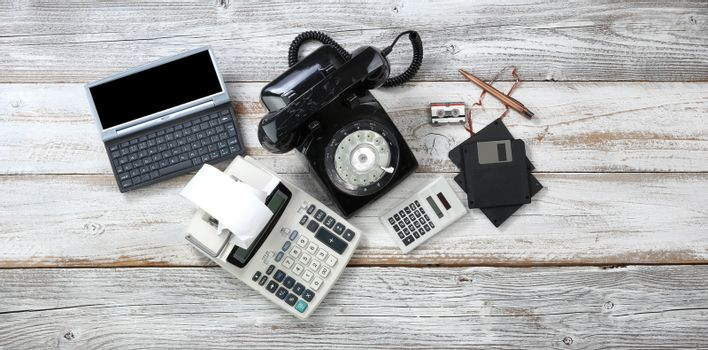Top view of obsolete technologies that includes rotary dial phon