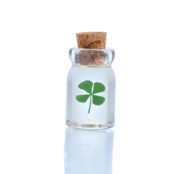 Four leaf clover in bottle for St. Patrick day symbol isolated o