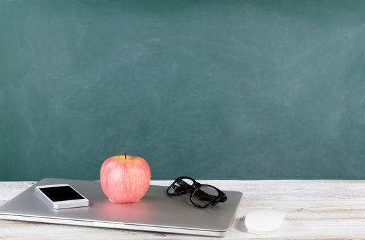 Back to school concept including modern technology with green ch