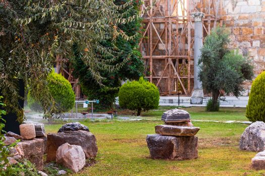 a wide shoot from a garden of church at ephesus - there many trees and green at photo. photo has taken at izmir/turkey.